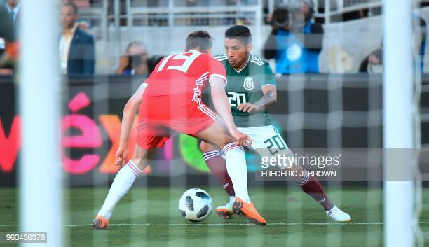 Javier Aquino of Mexico takes on Connor Roberts of Wales during their international soccer friendly at the Rose Bowl in Pasadena California on May 28...