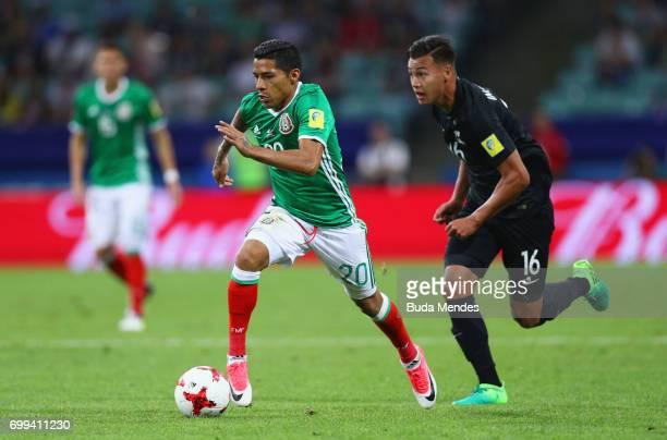 Javier Aquino of Mexico takes the ball past Dane Ingham of New Zealand during the FIFA Confederations Cup Russia 2017 Group A match between Mexico...