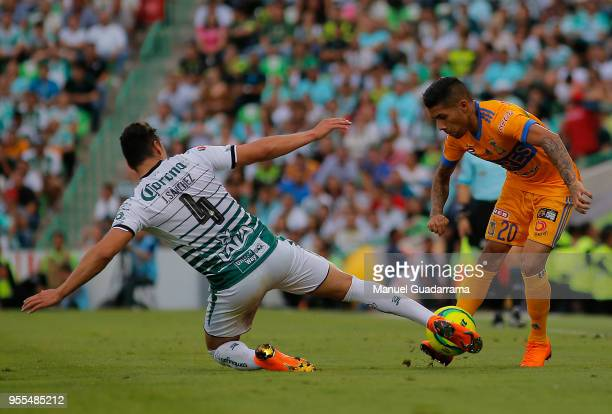 Javier Aquino of Tigres and Jorge Sanchez of Santos fight for the ball during the quarter finals second leg match between Santos Laguna and Tigres...