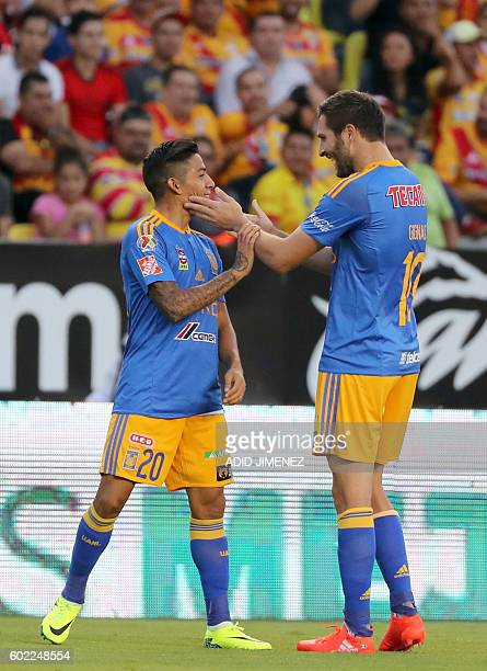 Javier Aquino of Tigres celebrates his goal with Andre Pierre Gignac during their Mexican Apertura 2016 tournament football match against Morelia at...