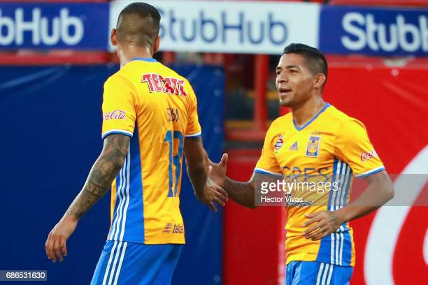 Javier Aquino of Tigres celebrates with Ismael Sosa aftaer scoring the first goal of his team during the semi final second leg match between Tijuana...