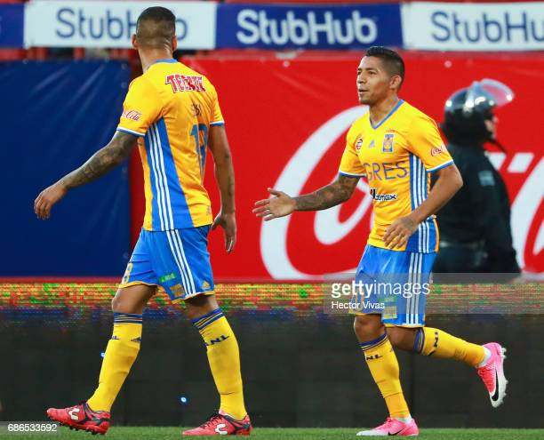 Javier Aquino of Tigres celebrates with Ismael Sosa after scoring the first goal of his team during the semi final second leg match between Tijuana...