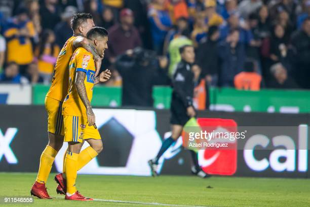 Javier Aquino of Tigres celebrates with teammate Eduardo Vargas after scoring his team's second goal during the 4th round match between Tigres UANL...