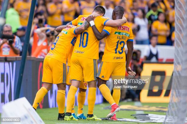 Javier Aquino of Tigres celebrates with teammates after scoring his team's first goal during the seventh round match between Tigres UANL and Lobos...