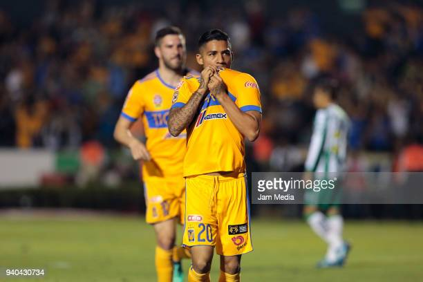 Javier Aquino of Tigres celebrates with teammates after scoring the third goal of his team during the 13th round match between Tigres UANL and Leon...