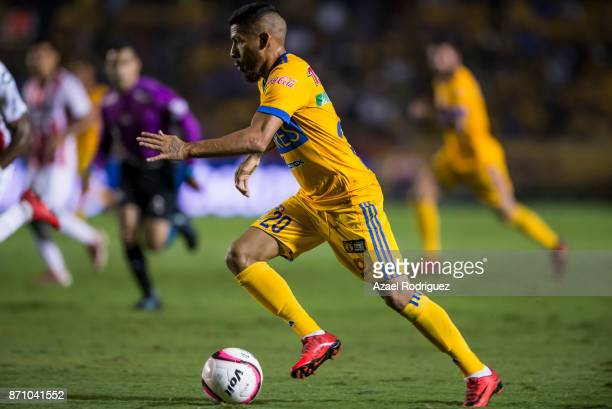 Javier Aquino of Tigres drives the ball during the 16th round match between Tigres UANL and Necaxa as part of the Torneo Apertura 2017 Liga MX at...