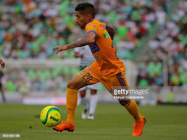Javier Aquino of Tigres drives the ball during the quarter finals second leg match between Santos Laguna and Tigres UANL as part of the Torneo...