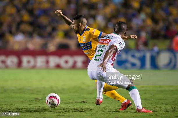 Javier Aquino of Tigres fights for the ball with Brayan Beckeles of Necaxa during the 16th round match between Tigres UANL and Necaxa as part of the...