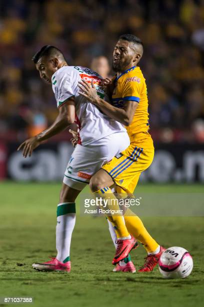 Javier Aquino of Tigres fights for the ball with Daniel Alvarez of Necaxa during the 16th round match between Tigres UANL and Necaxa as part of the...