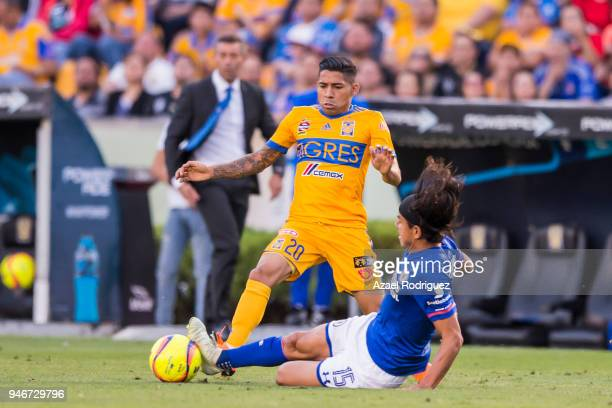Javier Aquino of Tigres fights for the ball with Gerardo Flores of Cruz Azul during the 15th round match between Tigres UANL and Cruz Azul as part of...