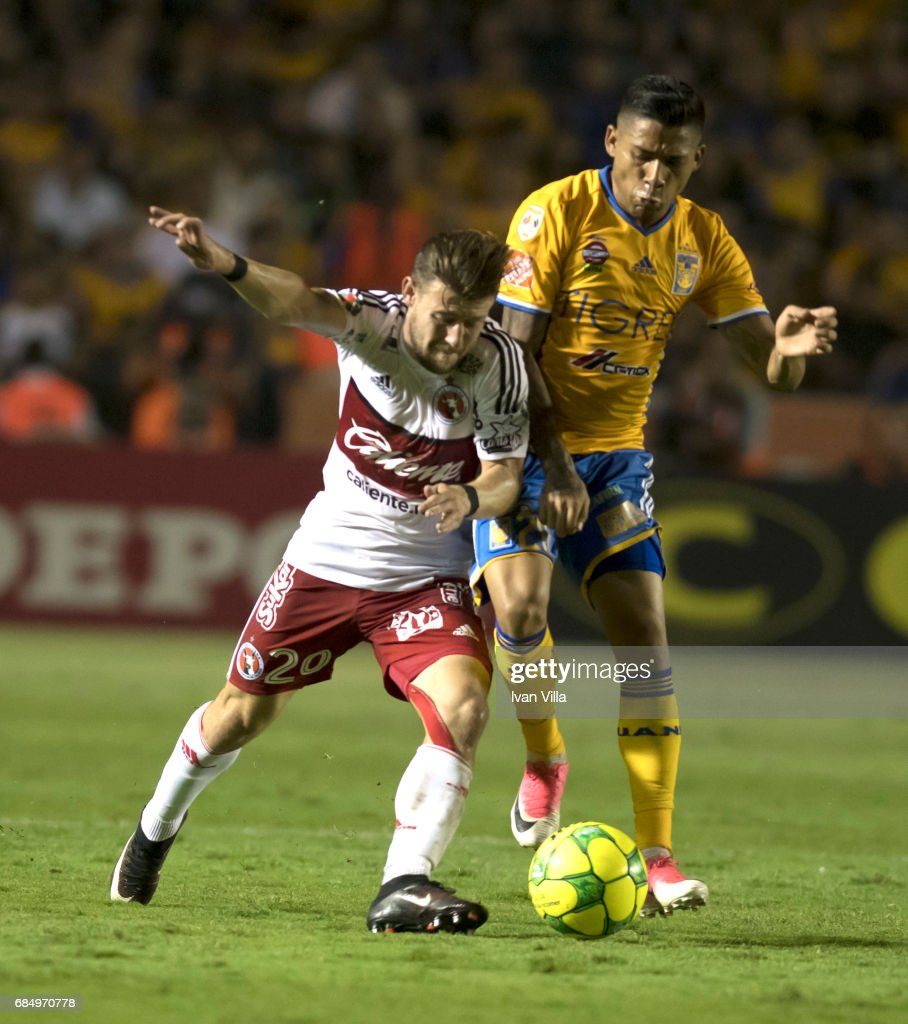 Javier Aquino (R) of Tigres fights for the ball with Paul Arriola (L) of Tijuana during the semi finals first leg match between Tigres UANL and Tijuana as part of the Torneo Clausura 2017 Liga MX Universitario Stadium on May 18, 2017 in Monterrey, Mexico.