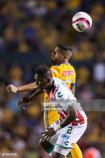 Javier Aquino of Tigres heads the ball with Brayan Beckeles of Necaxa during the 16th round match between Tigres UANL and Necaxa as part of the...