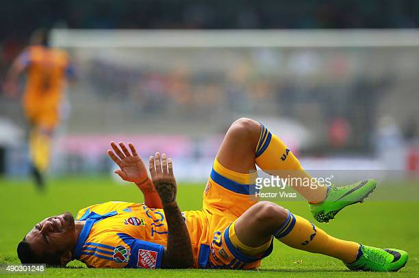 Javier Aquino of Tigres reacts during a 10th round match between Pumas UNAM and Tigres UANL as part of the Apertura 2015 Liga MX at Olimpico...