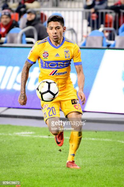 Javier Aquino of Tigres UANL runs with the ball during the CONCACAF Champions League Quarterfinal match between Toronto FC and Tigres UANL on March 7...