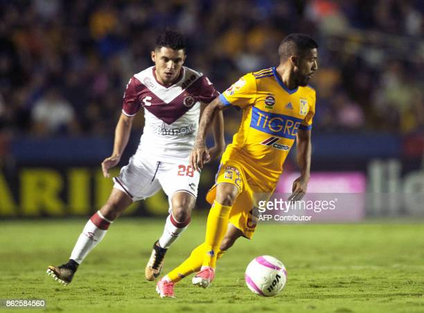 Javier Aquino of Tigres vies for the ball with Jesus Paganoni of Veracruz during the Mexican Apertura 2017 tournament football match at the...
