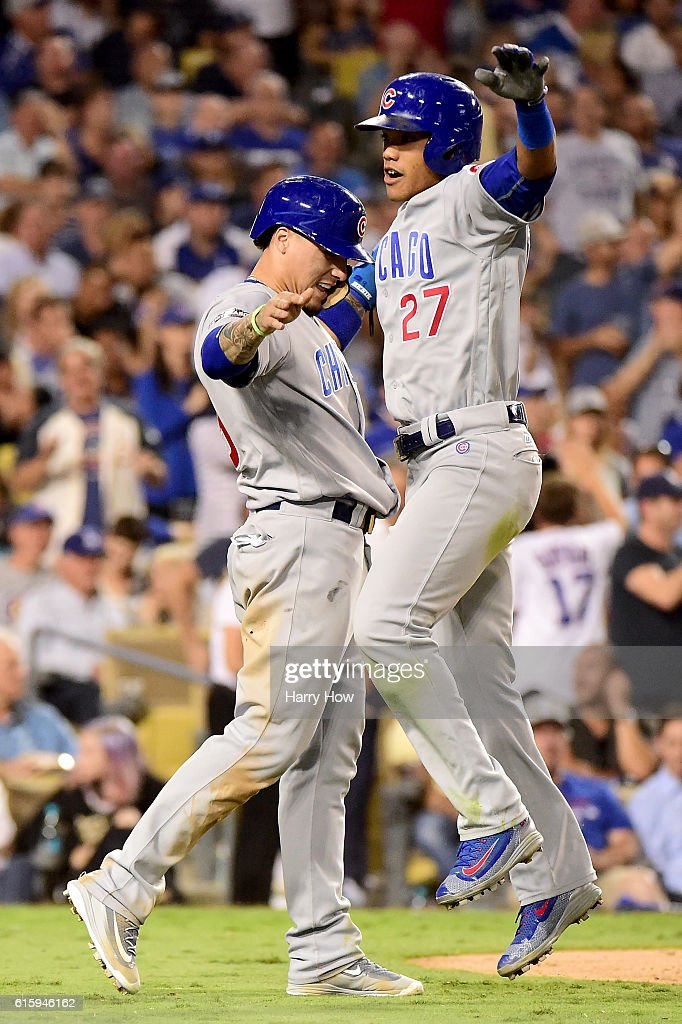 Javier Baez #9 and Addison Russell #27 of the Chicago Cubs celebrate after a two-run home run in the sixth inning against the Los Angeles Dodgers in game five of the National League Division Series at Dodger Stadium on October 20, 2016 in Los Angeles, California.