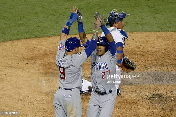 Javier Baez and Addison Russell of the Chicago Cubs celebrate after a tworun home run in the sixth inning against the Los Angeles Dodgers in game...