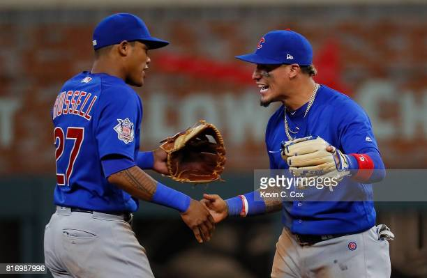 Javier Baez and Addison Russell of the Chicago Cubs react after their 43 win over the Atlanta Braves at SunTrust Park on July 17 2017 in Atlanta...