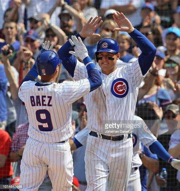 Javier Baez and Anthony Rizzo of the Chicago Cubs celebrate after scoring runs in the 6th inning against the Washington Nationals at Wrigley Field on...