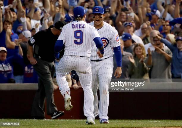 Javier Baez and Anthony Rizzo of the Chicago Cubs celebrate after beating the Washington Nationals 21 in game three of the National League Division...