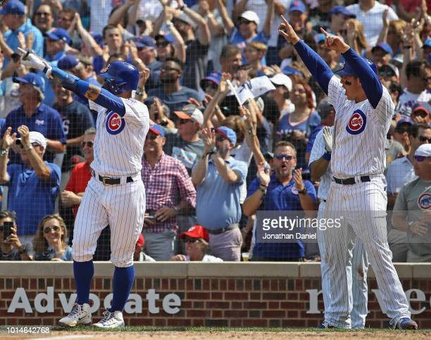 Javier Baez and Anthony Rizzo of the Chicago Cubs point to Jason Heyward at first base after Heyward hit a two run single in the 6th inning against...