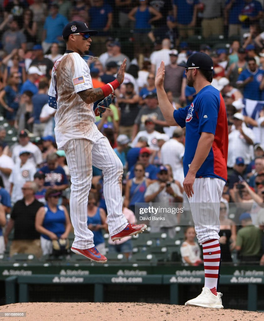 Javier Baez (L) and Kris Bryant #17 of the Chicago Cubs celebrate their win Detroit Tigers of the Chicago Cubs on July 4, 2018 at Wrigley Field in Chicago, Illinois. The Cubs won 5-2.