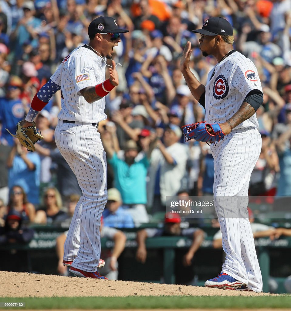 Javier Baez #9 (L) and Pedro Strop #46 of the Chicago Cubs celebrate a win over the Detroit Tigers at Wrigley Field on July 3, 2018 in Chicago, Illinois. The Cubs defeated the Tigers 5-3.