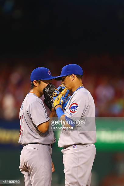 Javier Baez and starter Tsuyoshi Wada of the Chicago Cubs meet on the pitcher's mound against the St Louis Cardinals in the fifth inning at Busch...