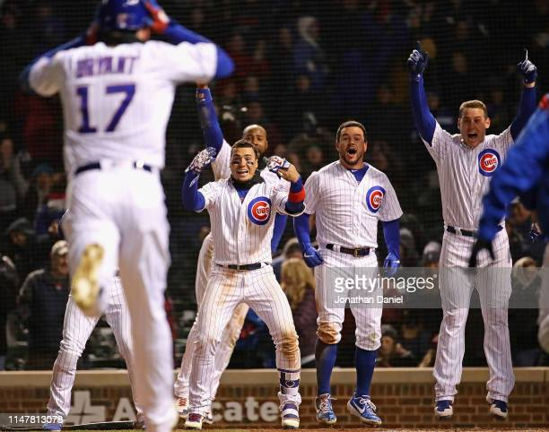 Javier Baez Jason Heyward Kyle Schwarber and Anthony Rizzo of the Chicago Cubs wait for Kris Bryant to cross the plate after he hit the gamewinning...