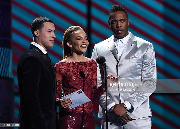 Javier Baez Leslie Grace and Arnoldis Chapman present the award for Best Tropical Fusion Album during the show of the 17th Annual Latin Grammy Awards...