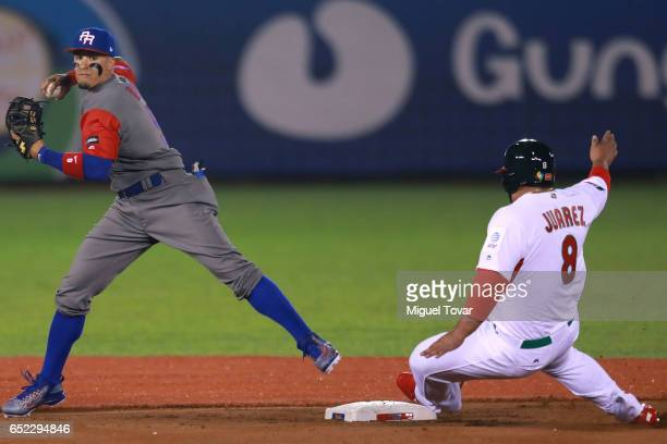 Javier Baez of Puerto Rico trows to first base in the bottom of the first inning during the World Baseball Classic Pool D Game 4 between Puerto Rico...