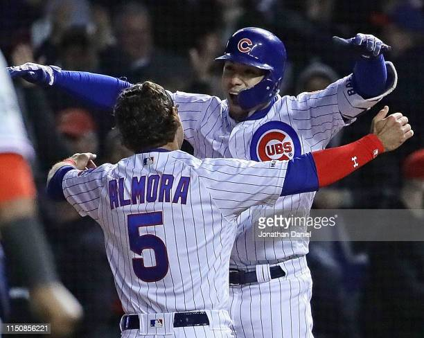 Javier Baez of the and Albert Almora Jr #5 of the Chicago Cubs celebrate after Baez got the game winning hit a pinchhit single in the 9th inning...