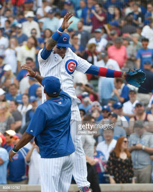 Javier Baez of the Chicago Cubs and Dave Martinez celebrate their win against the Toronto Blue Jays on August 19 2017 at Wrigley Field in Chicago...