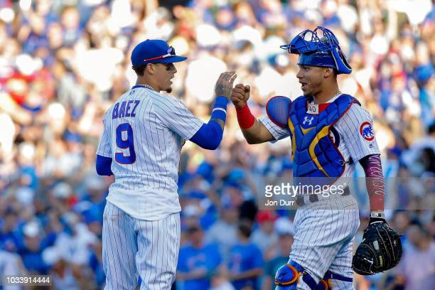Javier Baez of the Chicago Cubs and Willson Contreras celebrate their win over the Cincinnati Reds at Wrigley Field on September 15 2018 in Chicago...