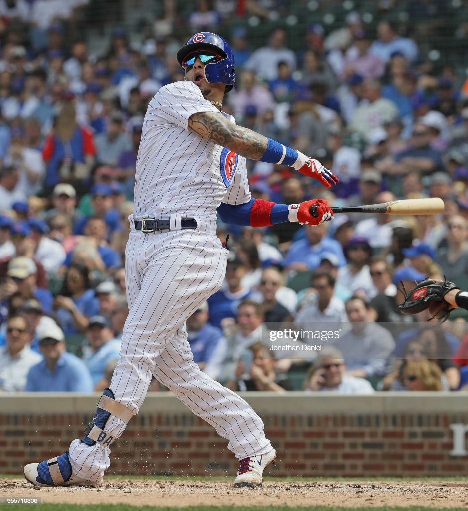 Javier Baez #9 of the Chicago Cubs bats against the Colorado Rockies at Wrigley Field on May 2, 2018 in Chicago, Illinois. The Rockies defeated the Cubs 11-2.