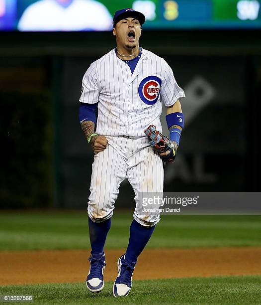 Javier Baez of the Chicago Cubs celebrates after beating the San Francisco Giants 10 at Wrigley Field on October 7 2016 in Chicago Illinois