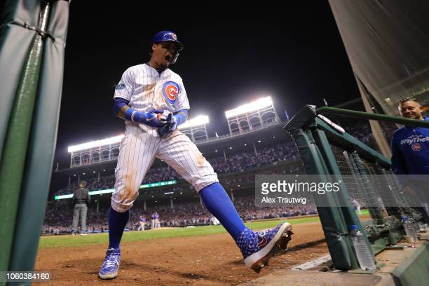 Javier Baez of the Chicago Cubs celebrates after hitting a gametying RBI double in the eighth inning during the National League Wild Card game...