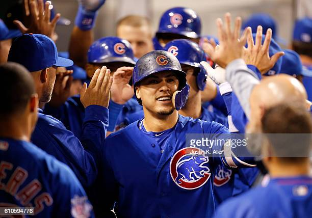 Javier Baez of the Chicago Cubs celebrates after hitting a grand slam home run in the fourth inning during the game against the Pittsburgh Pirates at...