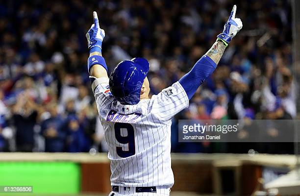 Javier Baez of the Chicago Cubs celebrates after hitting a home run in the eighth inning against the San Francisco Giants at Wrigley Field on October...