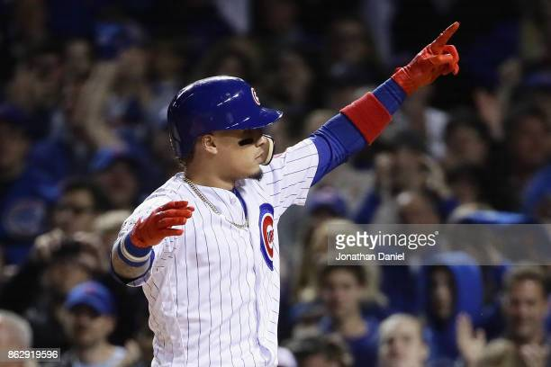 Javier Baez of the Chicago Cubs celebrates after hitting a home run in the second inning against the Los Angeles Dodgers during game four of the...