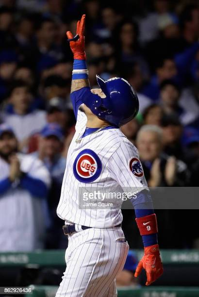 Javier Baez of the Chicago Cubs celebrates after hitting a home run in the fifth inning against the Los Angeles Dodgers during game four of the...