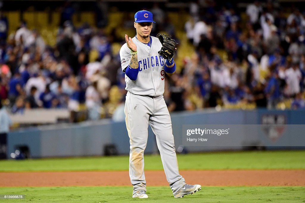 Javier Baez #9 of the Chicago Cubs celebrates after winning 8-4 against the Los Angeles Dodgers in game five of the National League Division Series at Dodger Stadium on October 20, 2016 in Los Angeles, California.