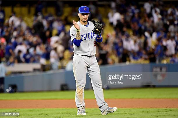 Javier Baez of the Chicago Cubs celebrates after winning 84 against the Los Angeles Dodgers in game five of the National League Division Series at...