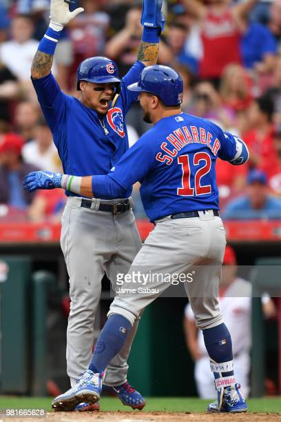 Javier Baez of the Chicago Cubs celebrates at home plate with Kyle Schwarber of the Chicago Cubs after Schwarber's tworun home run in the fourth...