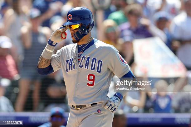 Javier Baez of the Chicago Cubs celebrates crossing the plate after hitting a 2 RBI home run in the eighth inning against the Colorado Rockies at...