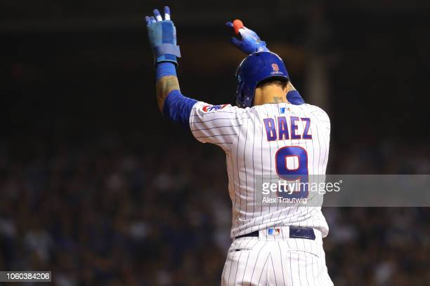 Javier Baez of the Chicago Cubs celebrates during the National League Wild Card game against the Colorado Rockies at Wrigley Field on Tuesday October...