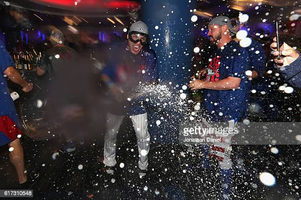 Javier Baez of the Chicago Cubs celebrates in the clubhouse after defeating the Los Angeles Dodgers 5-0 in game six of the National League...