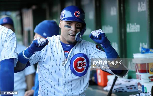 Javier Baez of the Chicago Cubs celebrates in the dugout following his game winning home run during the eighth inning of a game against the St Louis...