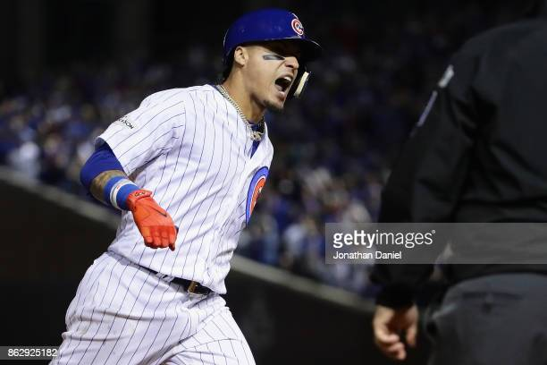 Javier Baez of the Chicago Cubs celebrates while rounding the bases after hitting a home run in the fifth inning against the Los Angeles Dodgers...