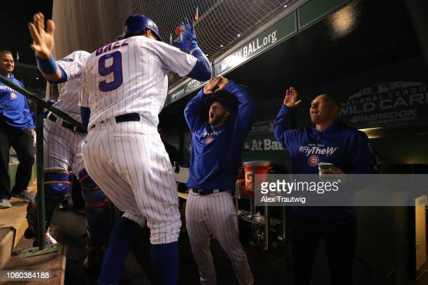 Javier Baez of the Chicago Cubs celebrates with David Bote after hitting a game-tying RBI double in the eighth inning during the National League Wild...